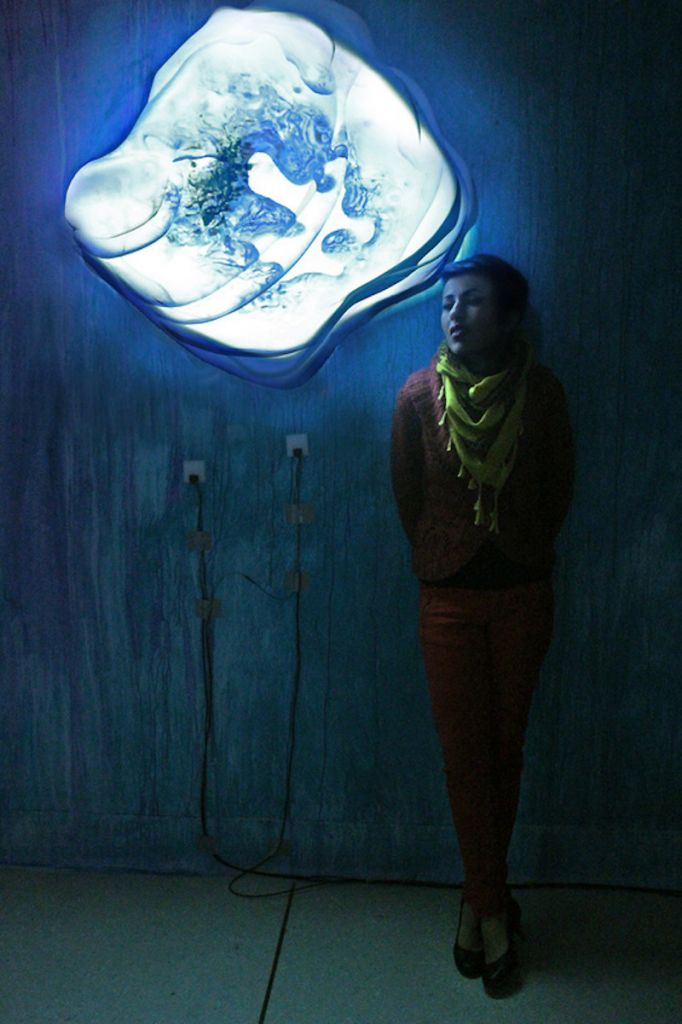 "Fig. 3. The artist with her collection, ""Vanimentis."" It will contain 4 digital interactive installations representing metamorphosis."